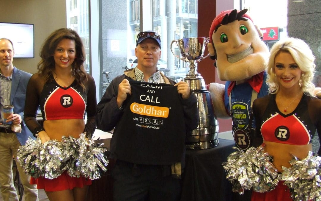 Goldhar raises the Grey Cup high to help raise money for Tim Horton's Camp Day